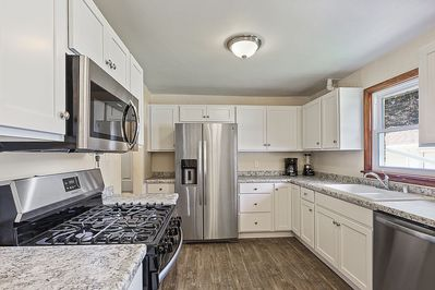 New Kitchen, stocked with all essentials, outfitted with SS Appliances.