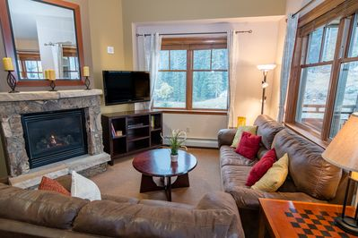 Comfortable living area with gas fireplace and flat screen TV await you at Zephyr 1703