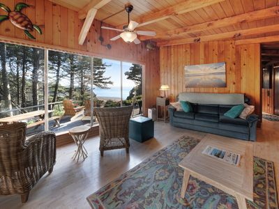 Photo for Impeccable oceanview home with private beach access & a large deck!