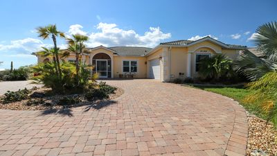 Photo for Exquisite Waterfront Pool/Spa Home - 3 bedrooms- Beaches, Golf and more!
