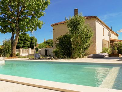 Photo for Comfortable cottage with heated pool and secluded garden in the Cognac region.