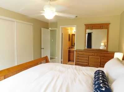 Master Bedroom with king bed, private bathroom, and balcony access.