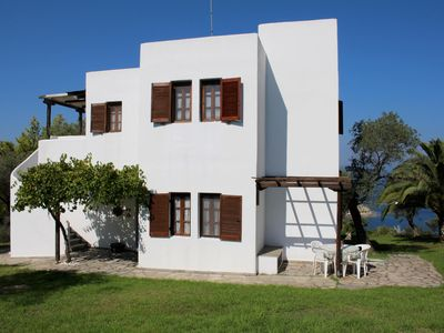 Photo for Komfortable holiday apartment with unique view, directly at the sea, Wifi, Ormos