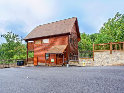 Photo for Beautiful log cabin with amazing mountain views, private hot tub, & shared pool