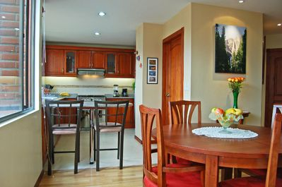 View from dining area to kitchen. Breakfast bar and dining table for 6.