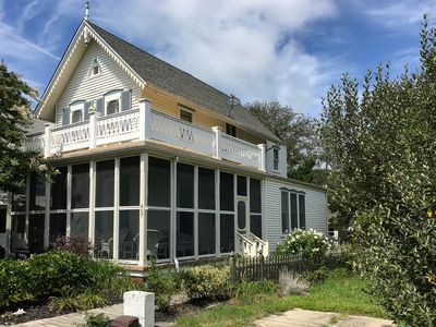 Photo for 1875 Victorian with wrap around screened porch, across the street from beach