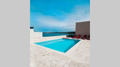 "Photo for ""Perfect runaway""in a quiet bay with sea view and pool relaxing area-app 1 for 6"