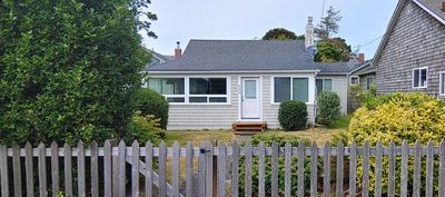 Photo for Comfy cottage KING BED 1 block from the beach. Everything you need is here!