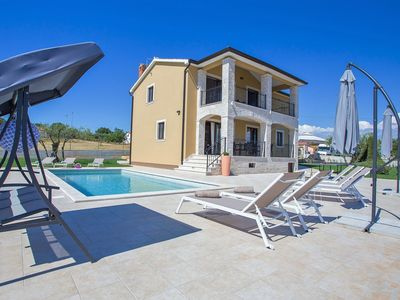 Photo for Newly built  4 bedrooms holiday house with pool, fully air-conditioned, garden..