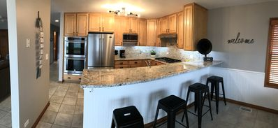 Fully appointed kitchen w/stainless appliances, granite and breakfast bar
