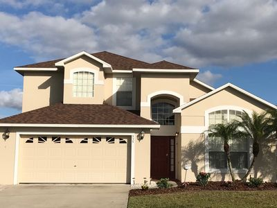 Photo for 5 BR,4 BA,2 Story Villa,10 minutes to Disney,Lakefront,Fishing,Heated Pool,WiFi