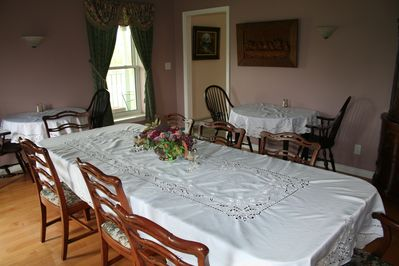 Dining Room with main table and 3 small tables
