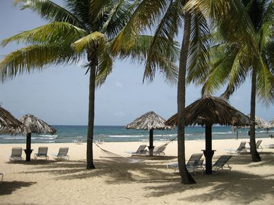Enjoy the Caribbean sun or relax in the shade on our beautiful white sand beach