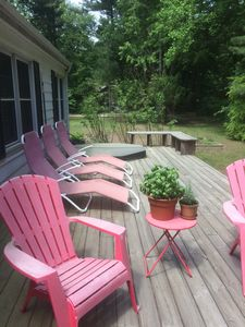 Back porch with chairs and hot tub
