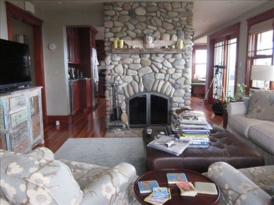 Living room.  Front to back fireplace.  Otherside faces kitchen.