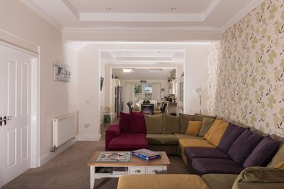 Open plan lounge, dining area for 10 guests and kitchen in the distance!