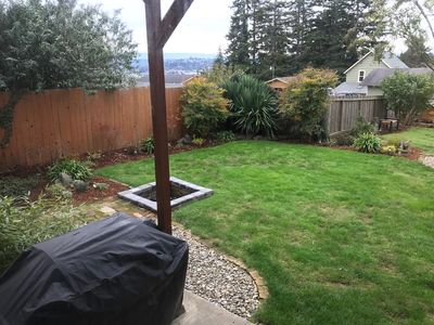 Barbecuer, fire pit in back yard