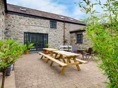 Photo for Y Wennol is a converted barn with lots of character. To the front is a sheltered sunny courtyard. Th