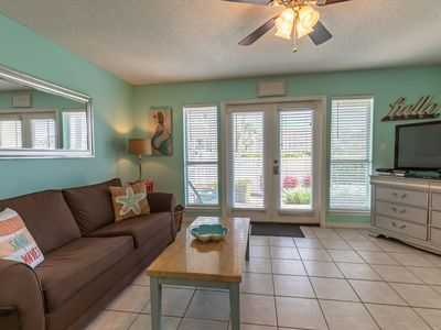Photo for Easy Beach Access & Walk-out to Pool * STUNNING CONDO * Across from Beach!