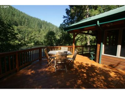 The wrap around deck with a gorgeous view of the McKenzie river and mountains.