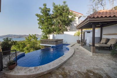Private pool area with covered lounge area