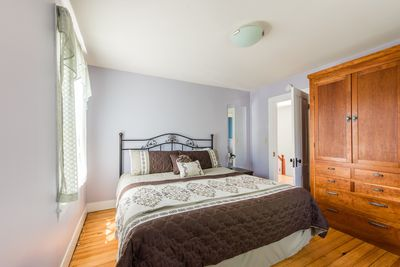 The master bedroom with king bed and a custom cherry wardrobe. So beautiful!