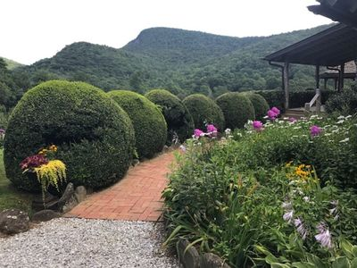 Gardens, flowers, and lush landscaping is abundant.