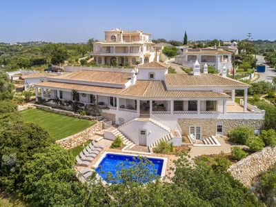 Photo for Fantastic sea / beach view, 4 bedroom villa, heated pool. Climate, BBQ