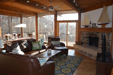 Open main floor - Living room, dining area, wrap-around deck, fireplace, HDTV