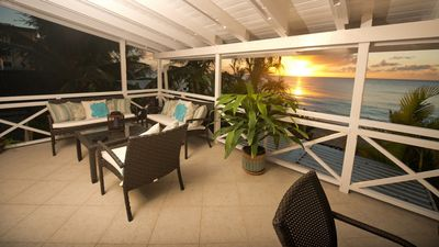 Photo for Two Bedroom Beach Front Apartment Located Directly on Paynes Bay Beach