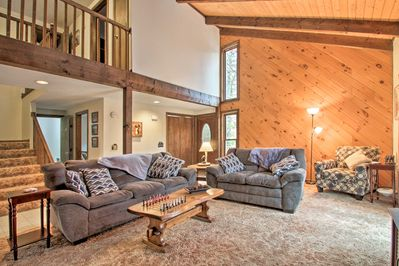 Plush furnishings and high vaulted ceilings set the environment for downtime.