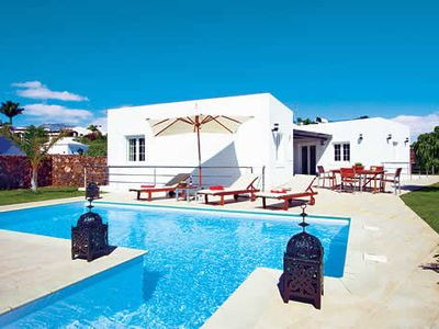 Photo for Stylish villa w/ heated pool, well kept gardens, table tennis & Wi-Fi