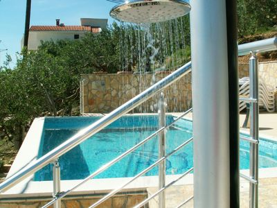 Photo for This 6-bedroom villa for up to 12 guests is located in Omis and has a private swimming pool, air-con