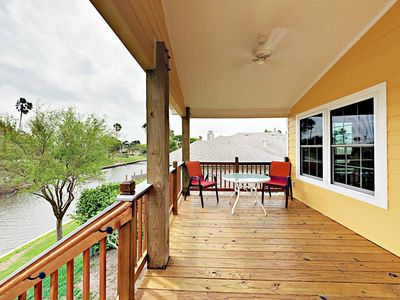 Photo for Unique 2BR Canal-Front House w/ Porch & Private Dock - Close to the Beach