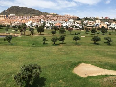 Photo for 2 bedroom penthouse apartment overlooking golf course,  sea view , 200m to beach