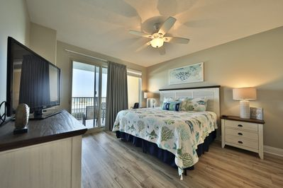Master bedroom with a king size bed.