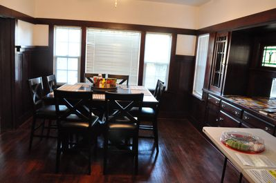 Dining area has seating for 12 with luxurious handcrafted built in cabinets!