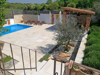 Photo for This 3-bedroom villa for up to 10 guests is located in Novigrad and has a private swimming pool, air