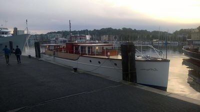 Photo for Classic motor yacht in the harbor of Flensburg