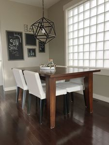 Dining table for 4 with additional folding chairs available.