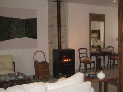 Sit by the cosy wood-burning fire, enjoy a glass, a good book and conversation