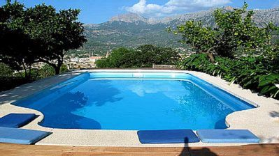 Pool side seating with amazing view over Soller and Tramantana Mountains