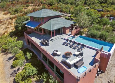 Aerial view of pool, deck and house