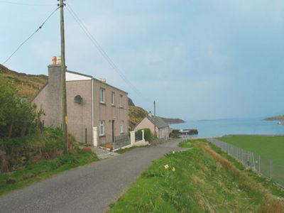 Photo for Holiday home with lovely sea and hill views