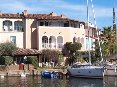 Photo for A waterside apartment located on the Ile des Quatre Vents at Port Grimaud.
