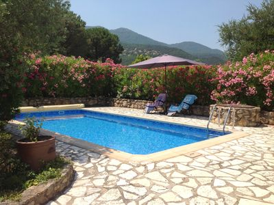 Photo for Villa with pool in secluded garden - amazing views - walking distance of village
