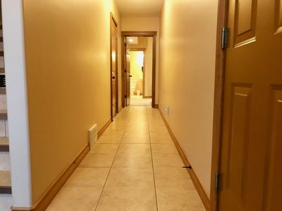 Entrance way leads down to the basement twin room with  its own full bath