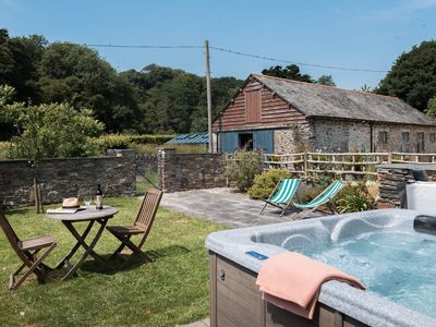 Photo for Award winning cosy cottage with private hot tub & log burner
