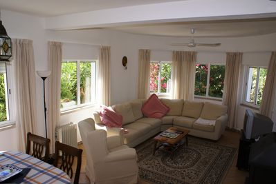 Sunny bright lounge with Sat TV, DVD, CD, WiFi, aircon, ceiling fans
