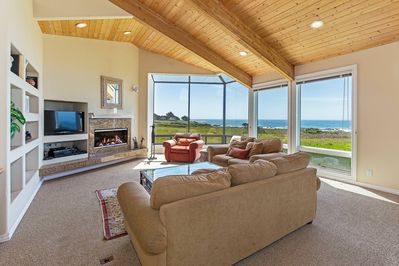 Modern living room with large windows and ocean view